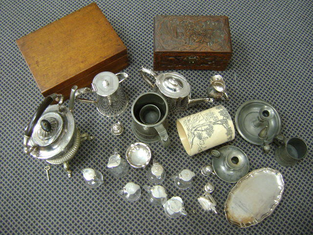 A collective lot comprising swan glass whisky tots with sliver mounts, silver cruets, some EP wares, pewter wares, boxes and a carved tusk (parcel)
