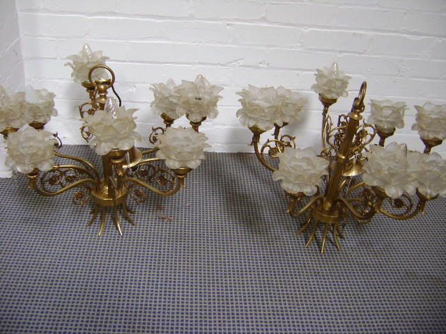 A pair of eight light chandeliers with flowerhead glass shades (2)