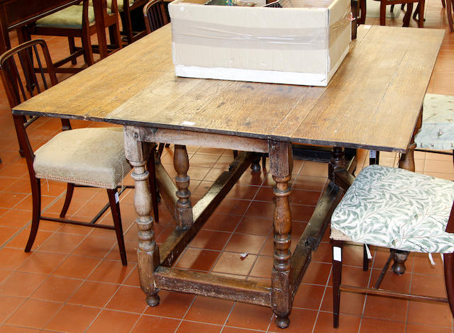 An oak drop leaf table with 17th century base