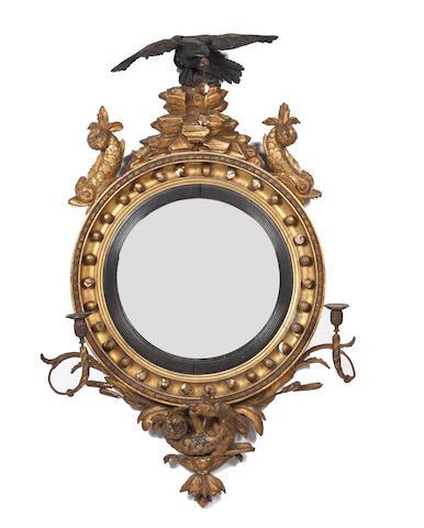 A Regency giltwood framed convex girandole