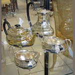 A silver four piece teaset with ebonised handles