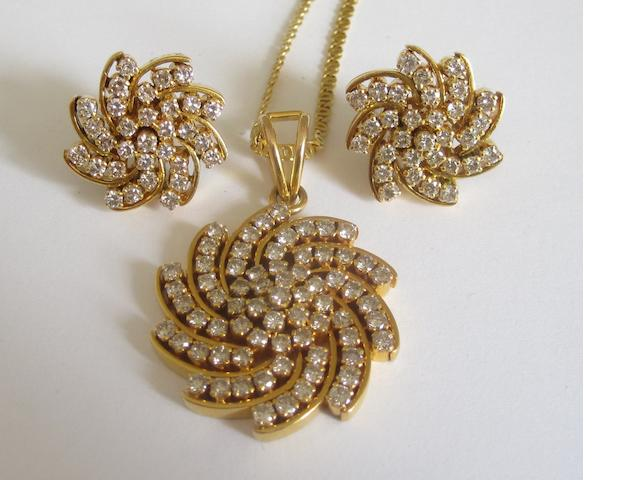 A diamond-set pendant and earring suite