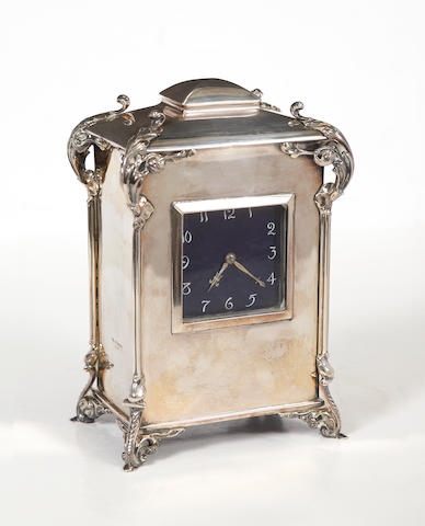 A silver cased mantel timepiece
