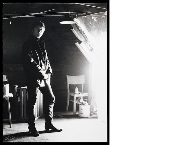 A photograph of John Lennon by Astrid Kirchherr,