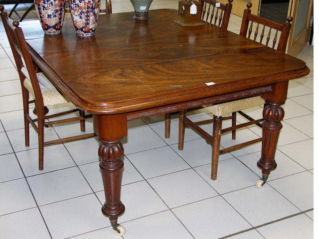 A mid 19th century mahogany extending dining table