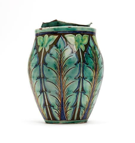 A lidded jar, Charles Collis for Della Robbia Circa 1900