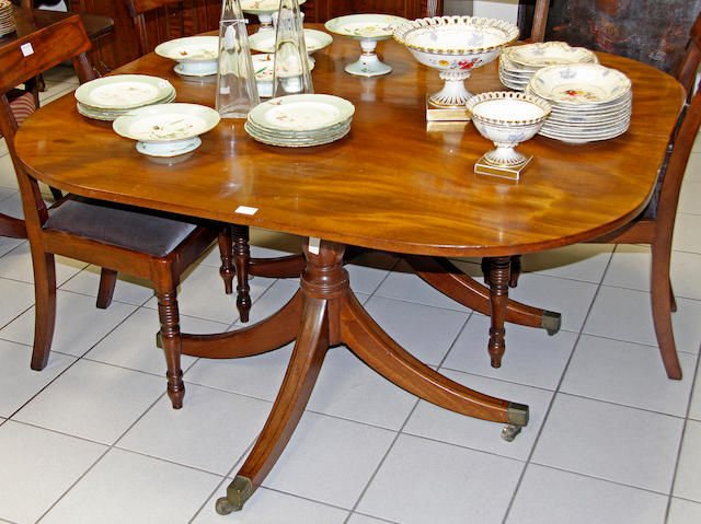 A pair of Regency mahogany dining table end sections