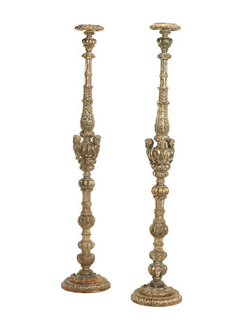 A pair of large Italian 19th century silvered-wood torchères
