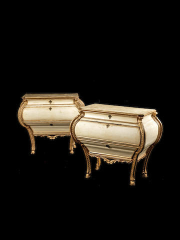 A pair of Venetian 18th century giltwood and white painted bombé commodes