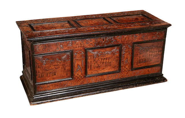 An Italian 18th century cedarwood blind fret carved and penwork decorated cassone