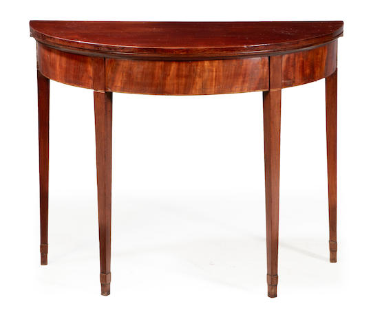 An early 19th century mahogany demi-lune tea table