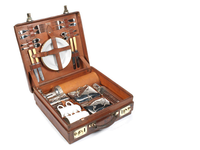 An early leather-cased 'En Route' four-person picnic set, by Drew & Sons, circa 1905,