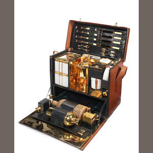 A fine and exceptional leather-cased four-person picnic set with gold-plated accessories, by Rendall & Co, Paris, 1904,  Specially commissioned for Sir Coleridge 'Roy' Kennard,