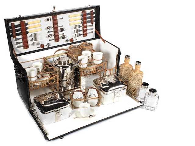 A fine and early leather-cased six-person picnic set, by G W Scott & Sons, circa 1911,