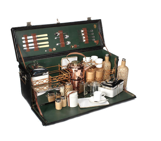 A large and impressive Edwardian 'Coracle' four-person picnic set, by G W Scott & Sons,
