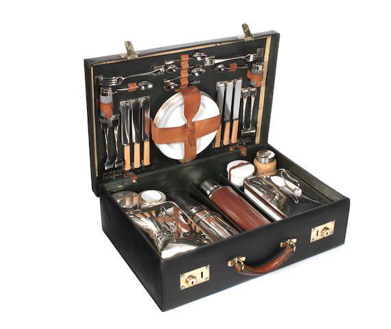 A fine suitcase picnic set for six-persons, by Finnigans, New Bond St, London, circa 1909,
