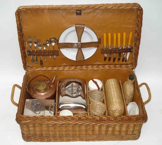 A six person wicker cased picnic set, by G W Scott & Sons, London,