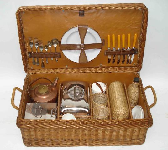 A six person wicker cased picnic set, by G W Scott & Sons, London,