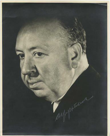Alfred Hitchcock: A signed large publicity photograph,