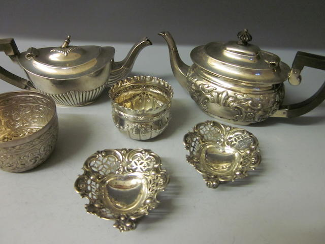 A small oval silver teapot by Nathan and Hayes,  Chester 1899,   (6)