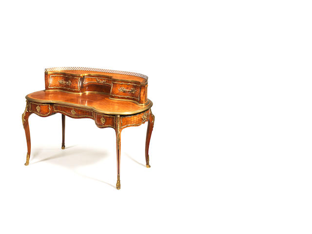 A French late 19th century, Louis XV style, ormolu-mounted kingwood, marquetry and parquetry bureau rognon