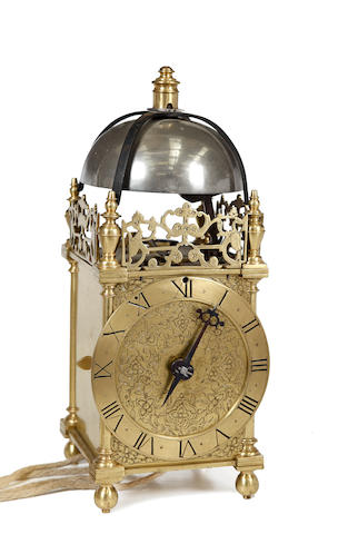 A very rare First Period brass lantern clock attributed to Henry Stevens, London
