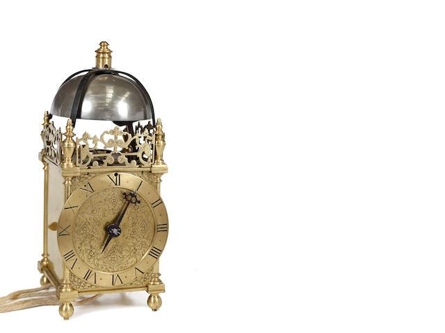 A brass lantern clock