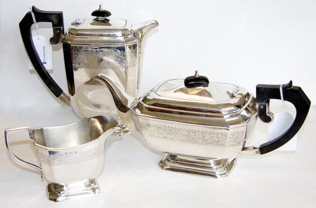 A silver three piece tea set, A silver three piece tea set,