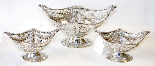 A late Victorian silver pierced basket on pedestal foot