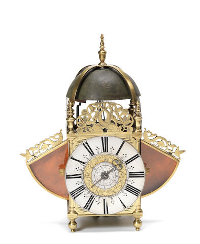 An 18th century winged lantern clock  Anonymous