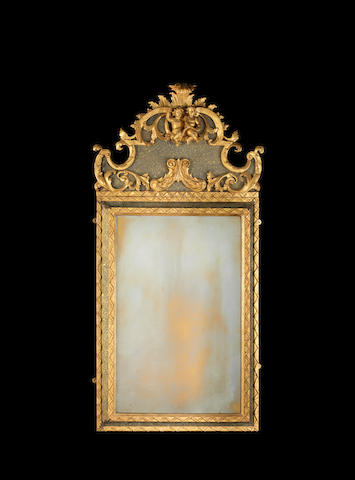 An Italian 18th century giltwood and painted faux-porphyry mirror possibly Sicilian