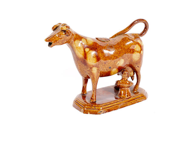 A Staffordshire redware cow creamer and cover, late 18th century
