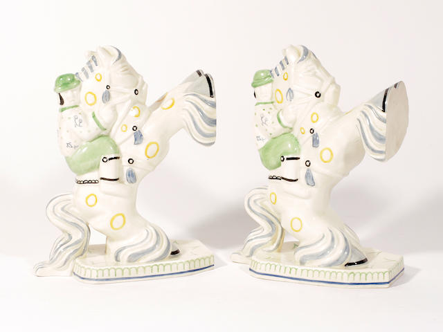 A pair of Royal Worcester bookends by Eric Aumonier, 'Horseman', dated 1932