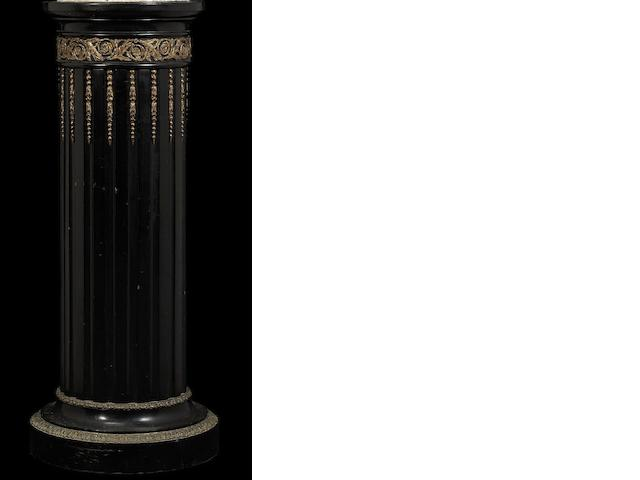A French late 19th century carved ebonised and gilt-bronze mounted column