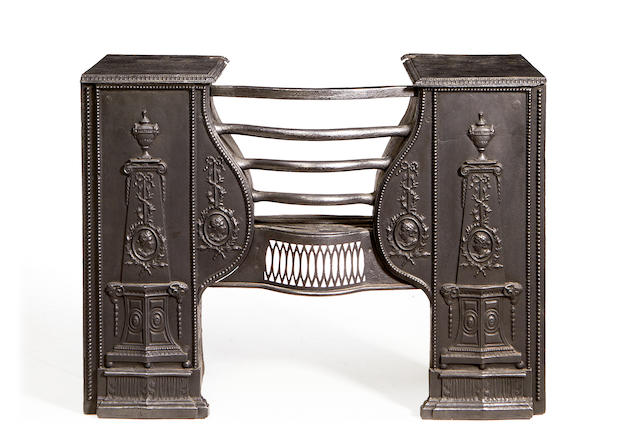 A late 19th / early 20th century cast iron firegratein George III style