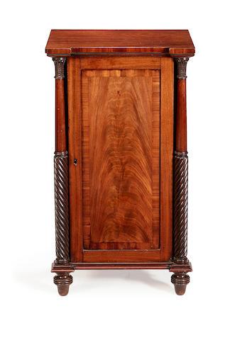 A Regency mahogany bedside cabinet