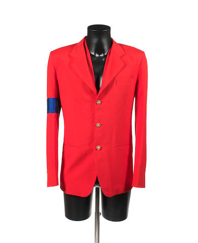 A red jacket with blue arm band,