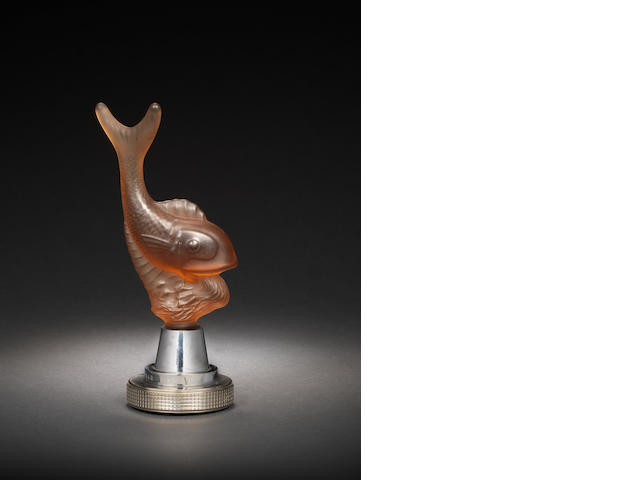 A 'Leaping Fish' glass mascot with rose tint, by Warren Kessler, British, 1920s,