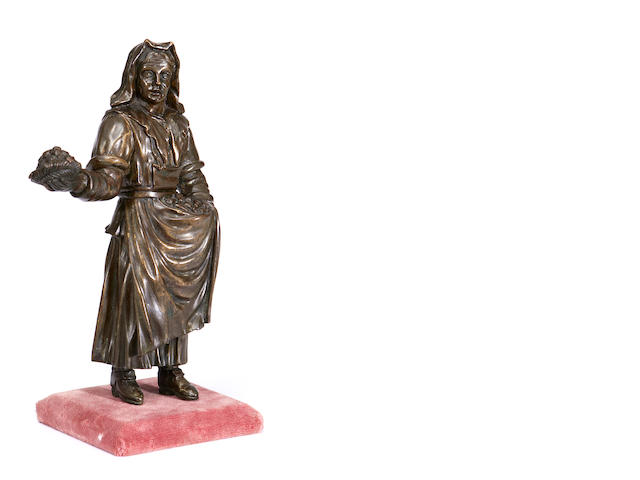 An 18th / 19th century French bronze genre figure of a peasant woman