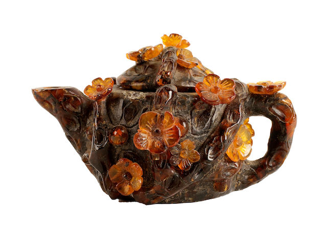 A Chinese amber miniature teapot and cover