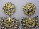 A pair of 19th century Indian brooches, converted from earrings