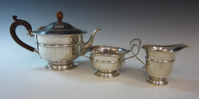 A silver three piece tea service London 1932,  (3)