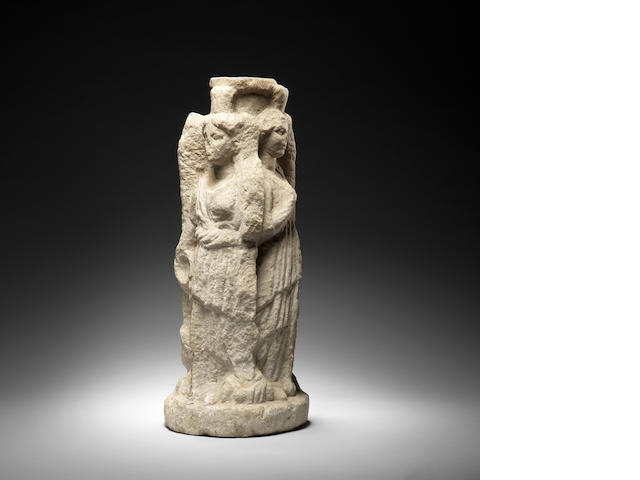A Roman marble Hekateion of three conjoined goddesses