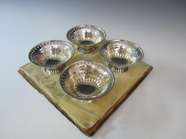 A silver set of four circular pierced dishes by Walker and Hall, Sheffield 1911  (4)