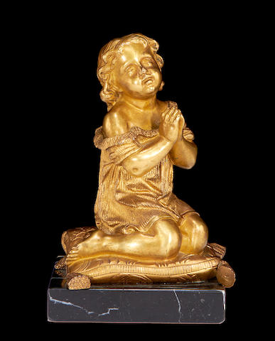 Gilt bronze seated child-19th century on later base