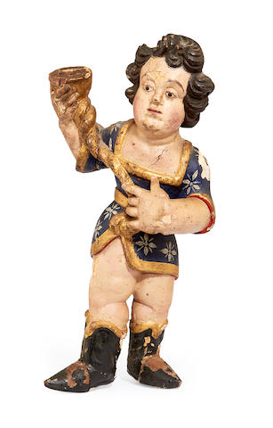 An early 18th century carved wood and polychrome decorated figure