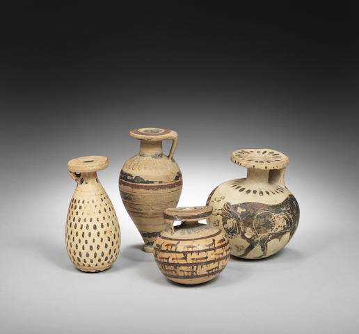 Four small Corinthian vessels