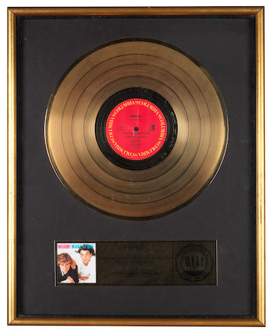Wham!: An RIAA 'Gold' award for the album 'Make It Big',  presented to Andrew Ridgeley,