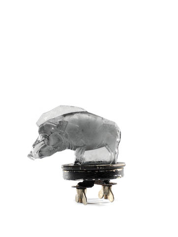 A pre-War 'Sanglier' mascot in fumée glass, by Rene Lalique, French, introduced 3rd October 1929,