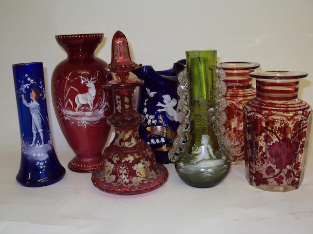 A small collection of enamelled coloured glassware